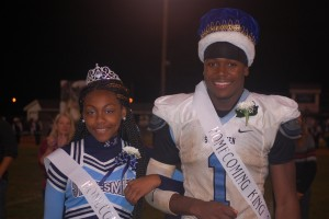Jaliyah Walton (left) and Joseph Reed (right) stand together as Homecoming King and Queen after they were crowned during halftime. (Photo by Noel Oliver)