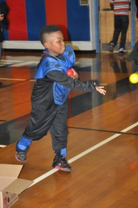 Concentration is key for Edmond Casper as he tries his luck at one of many games at the CMS fall carnival.