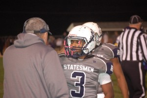 Photo by Titus Mohler | Randolph-Henry High School senior Fred Blow-Tydings receives instructions from Statesmen Head Coach Mark McPherson during Friday night's homecoming game.